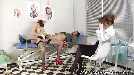 Bound male slave of two medical bitches