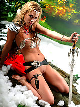 Pussy, Sexy topless blonde amazon babe posing with two swords and masturbates