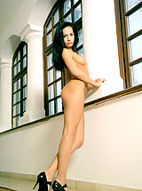 Secretary, RIA - Well endowed dark haired model is very provocative in this indoors set.
