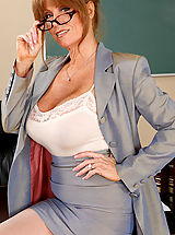 Secretary, Busty redhead teacher Darla Crane has hot sex on her desk with one of her students.