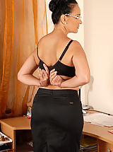 Secretary, Office gal Ria Black takes a break from her duties to spread her pussy