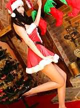 Secretary, This stunning brunette will be making everyones xmas list in this strapless minidress and high heels.