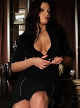 Secretary, Beautiful busty brunette, Aria Giovanni, gets dressed up in her black shirt, skirt, heels with her long black hair up. She lets her hair down and strips off her secretary look.