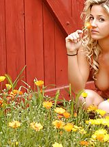 Public Nudity, Lia 19 plays in a bed of flowers