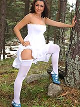 Public Nudity, Bryoni-Kate in snow a strapless summer dress, white cotton panties and white hosiery.