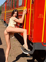 Public Nudity, KATYA - Outdoor nudity with this brunette on a red train.