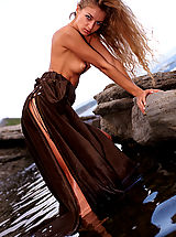 Public Nudity, Gorgeous redhead shows her pussy posing on the rocks
