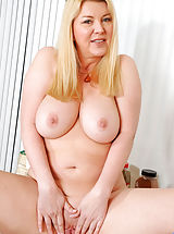 Sexy Legs, Busty blonde cougar Venice Knight stuffs her cock craving pussy with a glass dildo