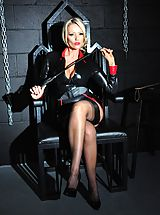 Sexy Legs, Horny Mistress Lucy Zara strips off in dungeon whilst playing with her kinky bondage gear