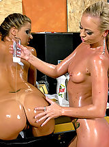 Lesbian Sex, Two hot horny lesbian chicks playing with massaging oil