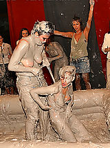 Lesbian Sex, Hot babes tearing off their tops while wrestling in the mud