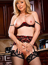 Lingerie, Sexy MILF Nina Hartley teaches her son a lesson by fucking his friend.
