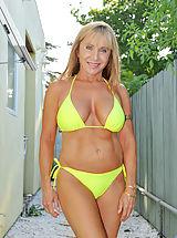 Bikini, Busty milf Luna wears a bikini and gives a peek of her sizzling hot mature frame as she chills by the pool