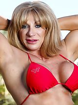 Micro Bikini, Muscle builder Kat Connors undresses off her swimsuit and shows us her immense clit.