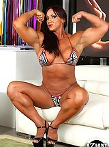 Micro Bikini, Bodybuilder Amber Deluca strips off her bikini and flexes her huge muscles.
