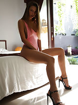 High Heels, Elin bares her smoldering hot body with amazing breasts as she strips on the bed.