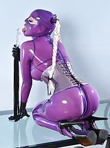 High Heels, Latex Lucy fucks her bare twat with a glass toy